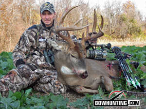 Hunter with trophy whitetail buck