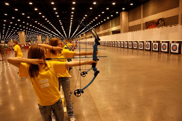 school girls shooting bows