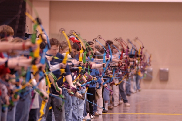 lots o kids shooting bows